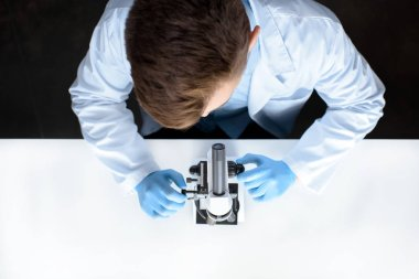 Top view of scientist working with microscope in laboratory stock vector