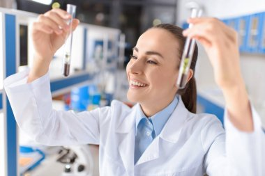 scientist with laboratory tubes
