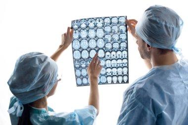 surgeons examining x-ray image
