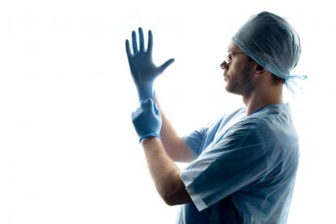 surgeon wearing gloves