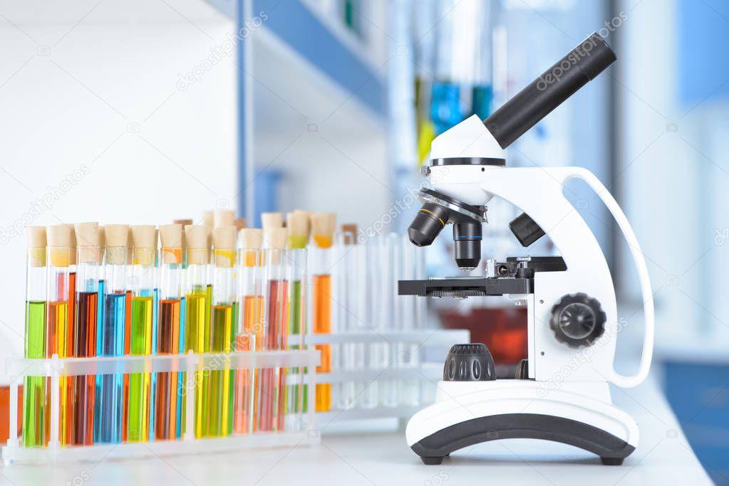 laboratory tubes and microscope