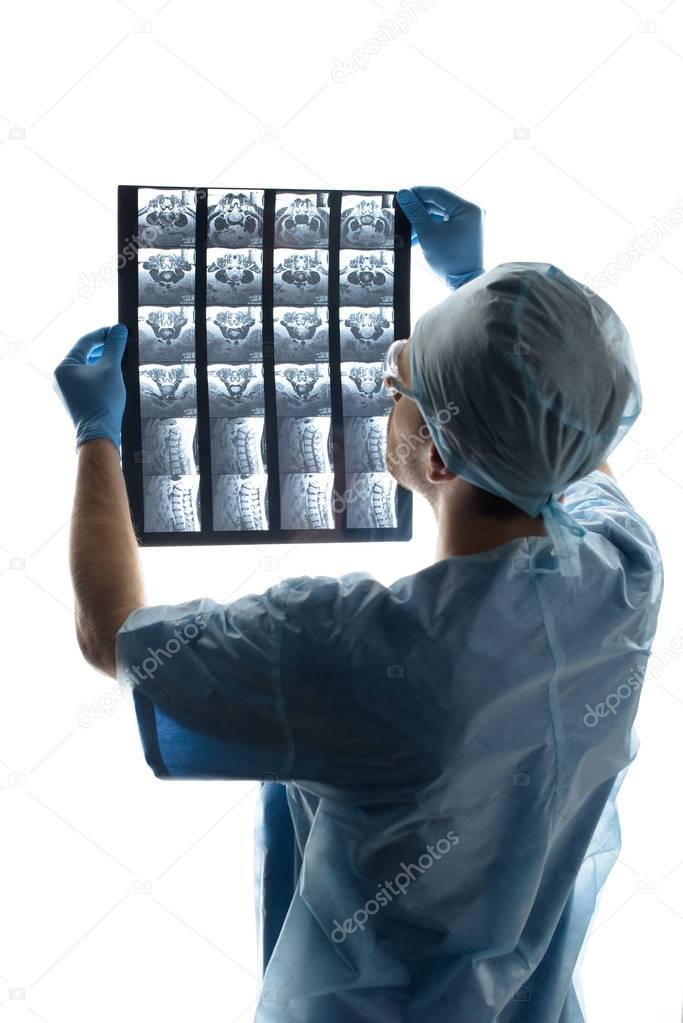 surgeon examining x-ray image