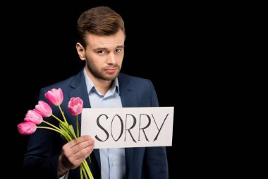 Man with tulips and sorry sign