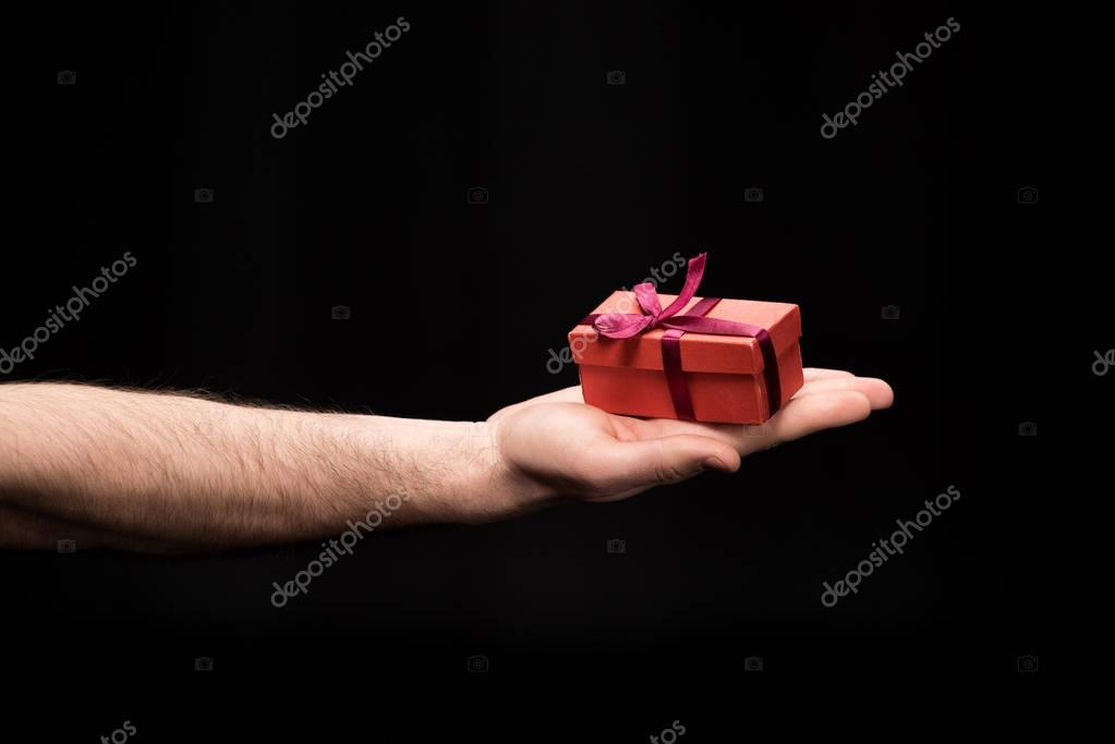 man holding gift box