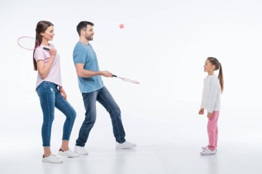 Young family with badminton rackets