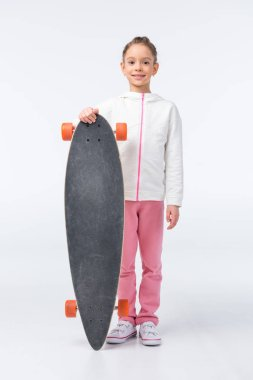 little girl with skateboard