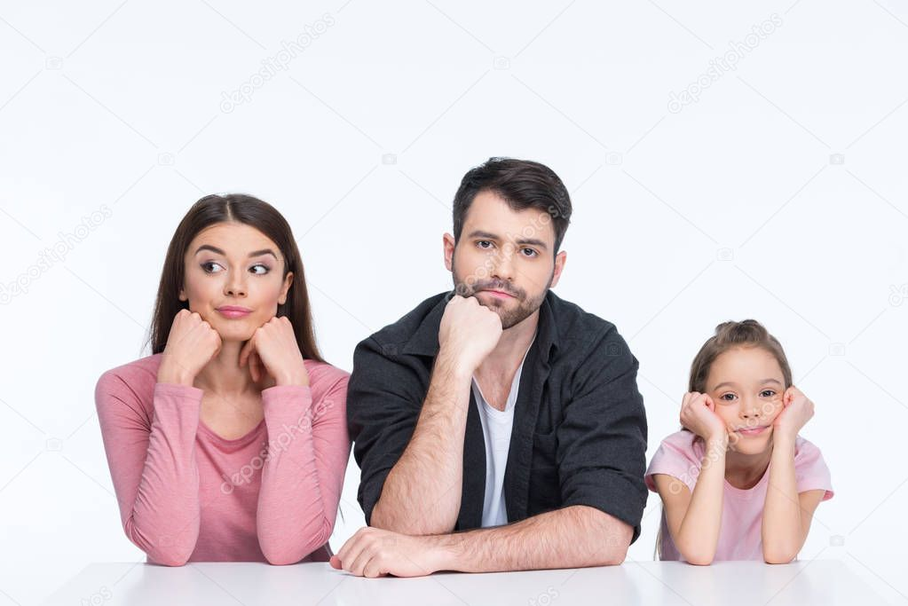 Pensive young family