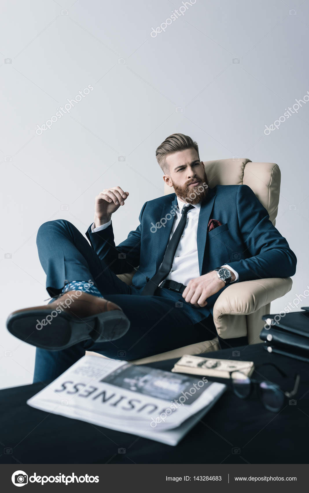 Businessman sitting in armchair stock photo for Sitting in armchair