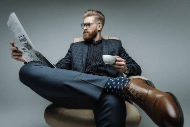 stylish businessman sitting in armchair