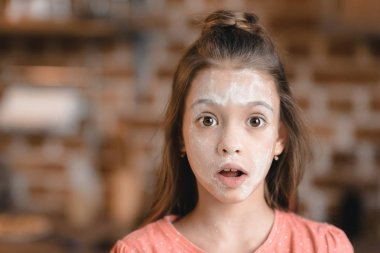 Girl with flour on face