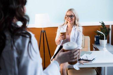 beautiful doctors drinking coffee