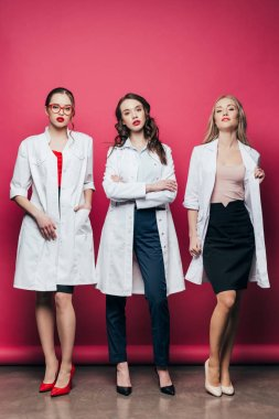young girls posing in white coats