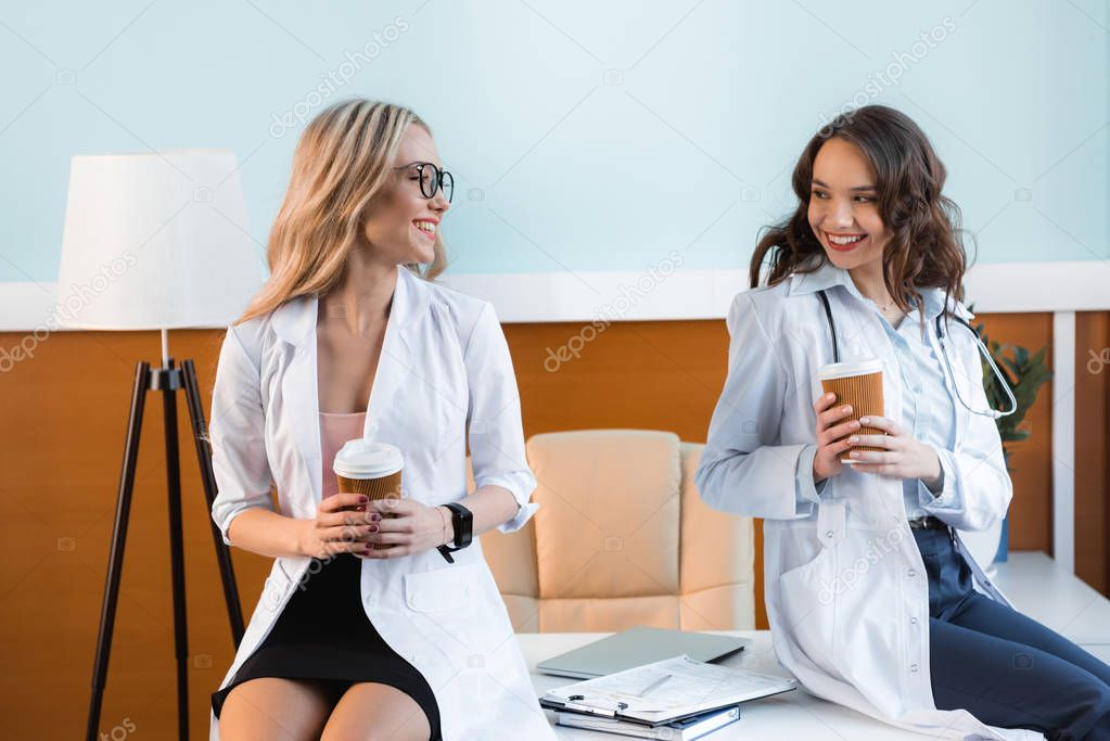 beautiful doctors drinking coffee