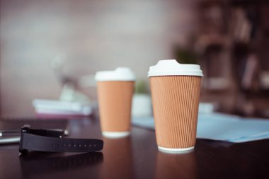 Smartwatch and coffee cups