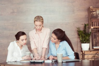 businesswomen working and discussing
