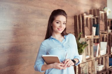 attractive businesswoman with notebook