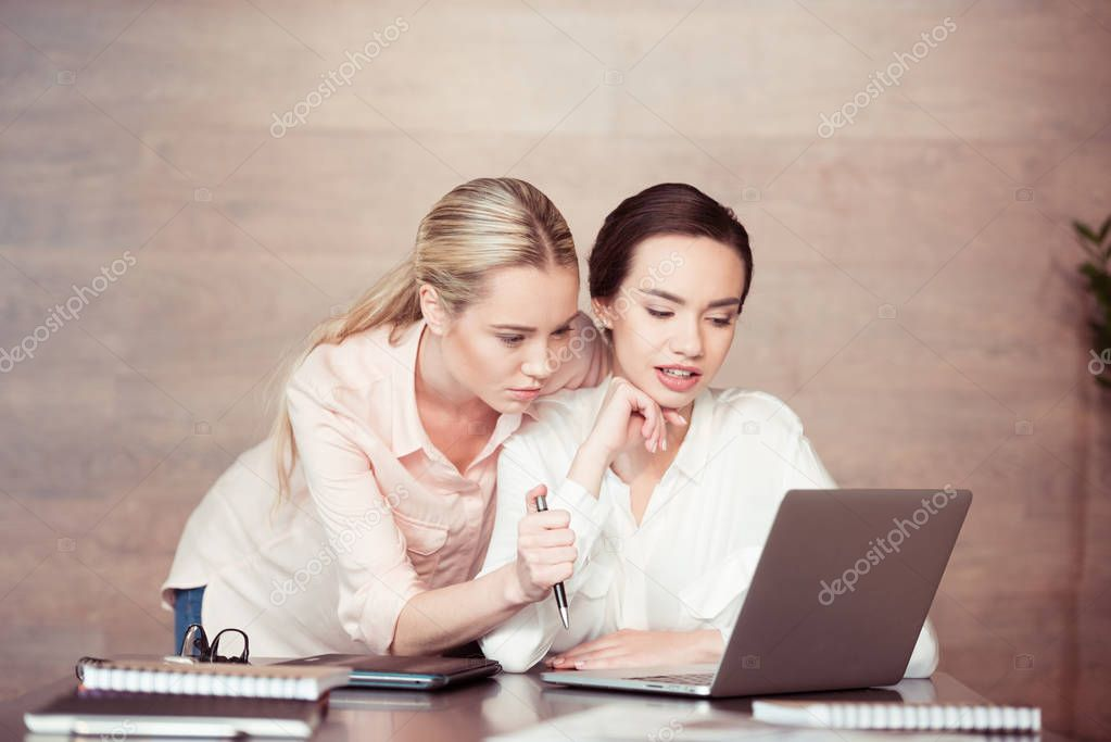 Two attractive businesswomen