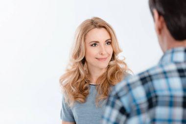 Woman looking on man