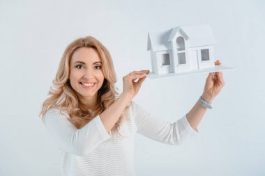 woman with house model