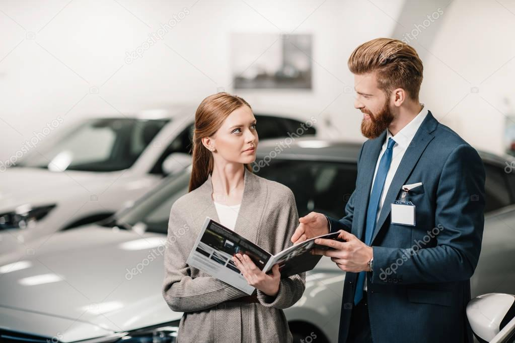 salesman and customer in dealership salon