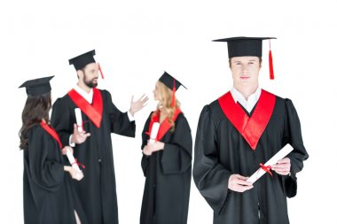 Happy students with diplomas