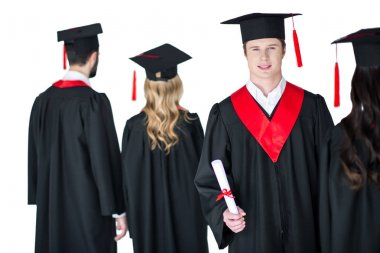 student in graduation cap with diploma