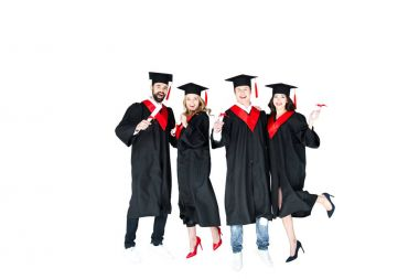 students in graduation caps with diplomas