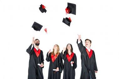 students throwing graduation caps