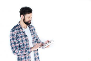 student holding copybooks