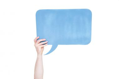 Person holding blue empty speech bubble with copy space isolated on white stock vector
