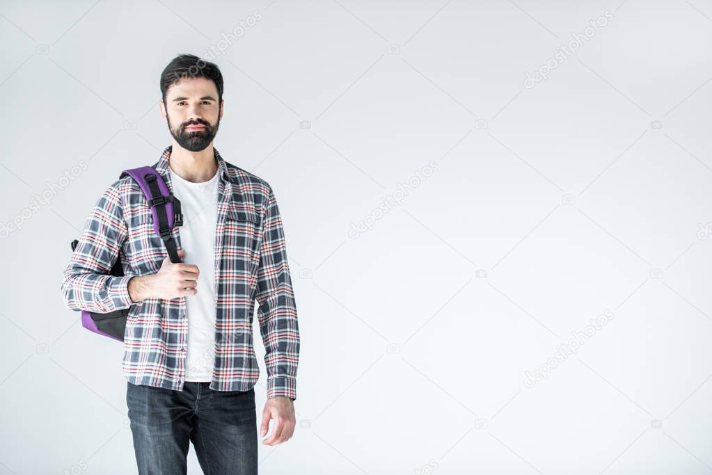 bearded student with backpack