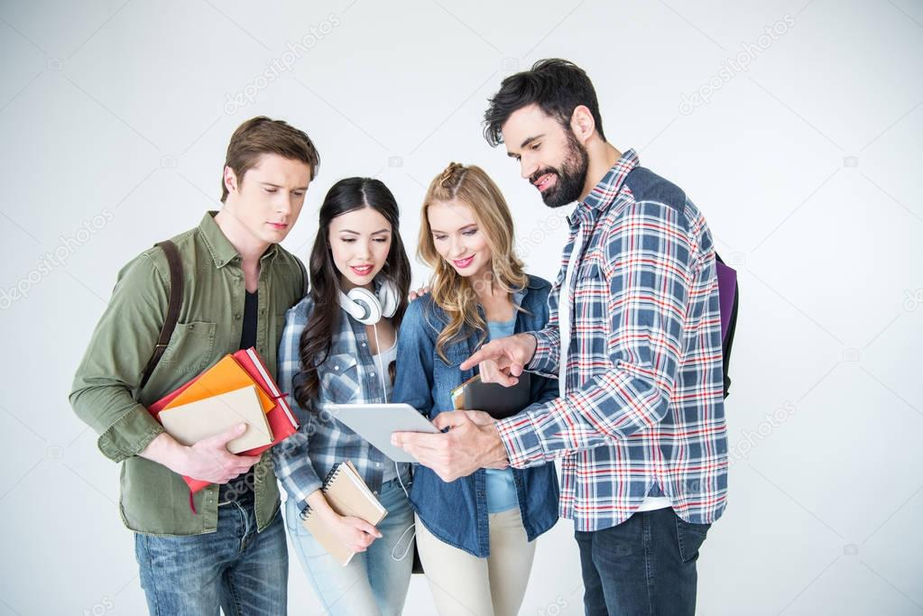 four students with books