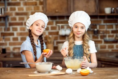 kids making dough for cookies