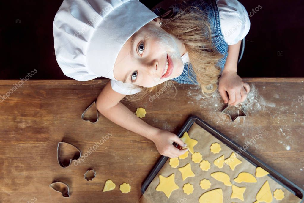 girl with raw shaped cookies