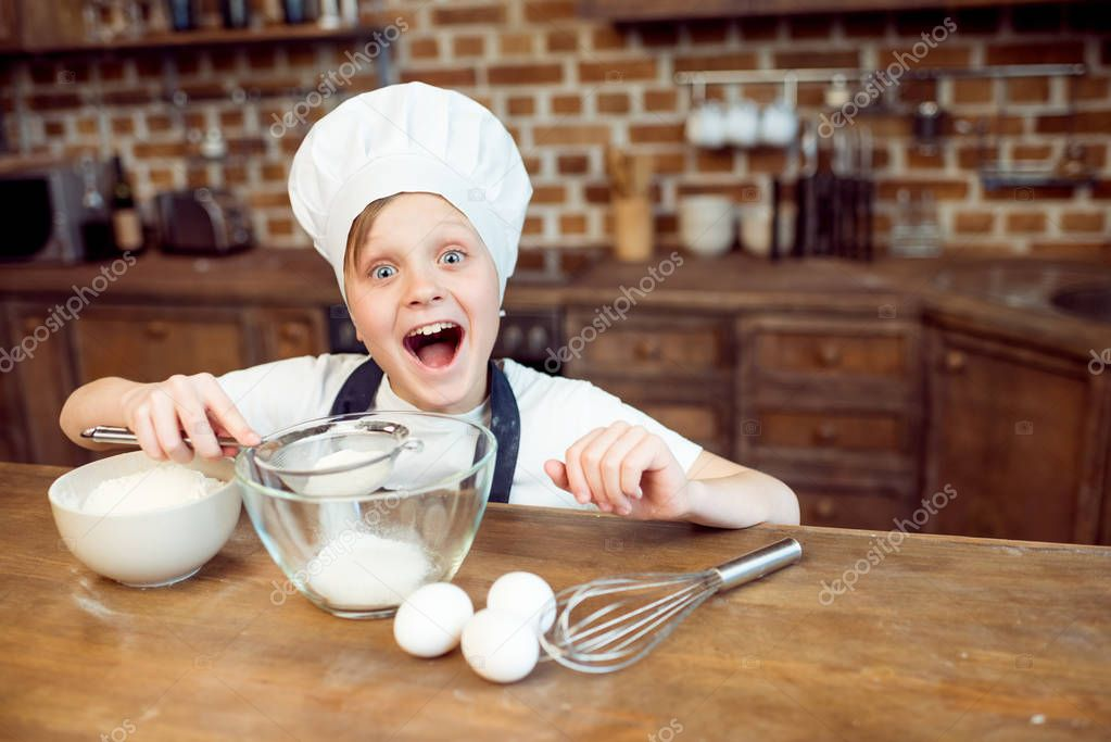 boy pouring sugar in bowl