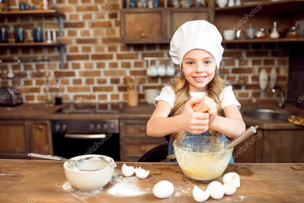 girl making dough for cookies