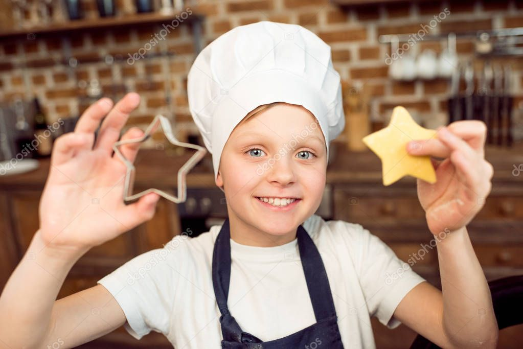 boy holding raw dough