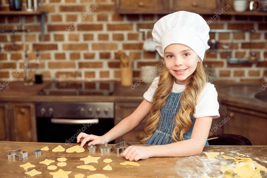 girl making shaped cookies