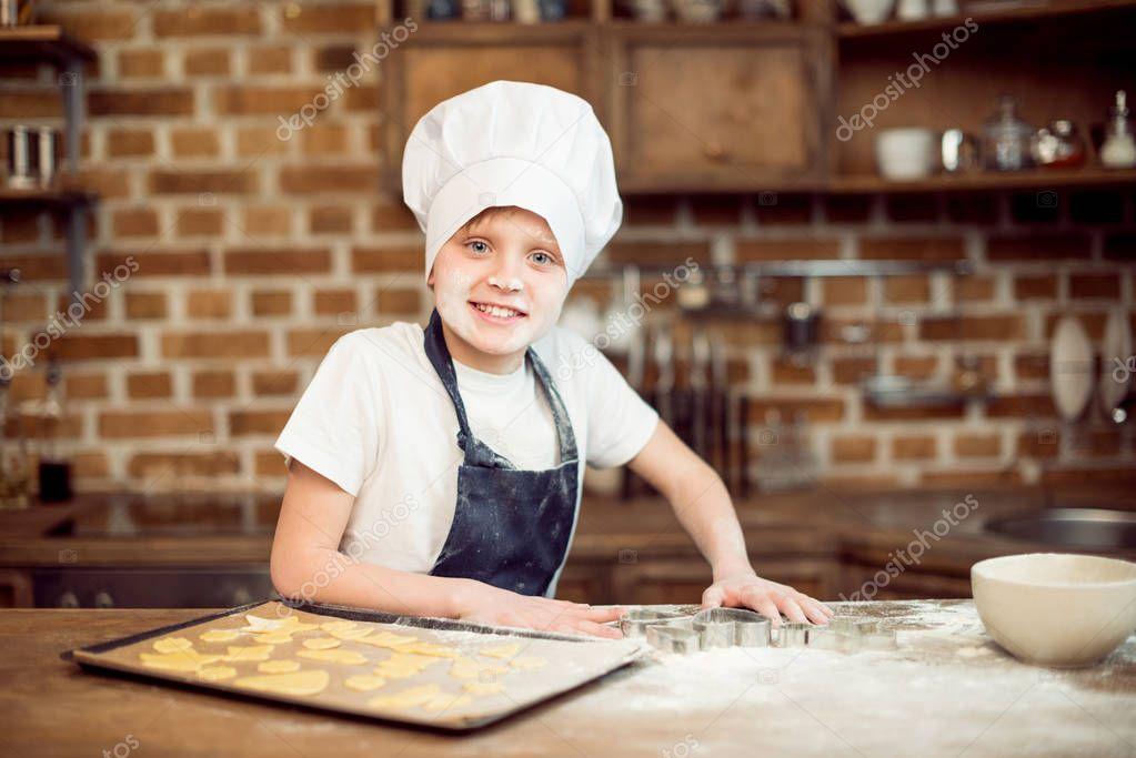 boy making shaped cookies