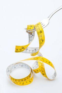 measuring tape on fork