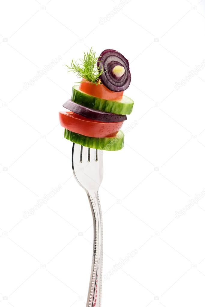 sliced vegetables on fork