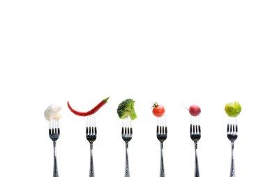 fresh vegetables on forks