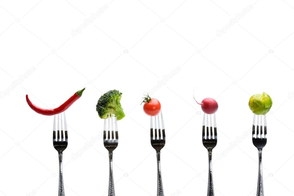 fresh vegetables on forks
