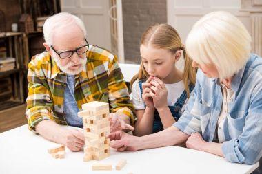 Family playing jenga game