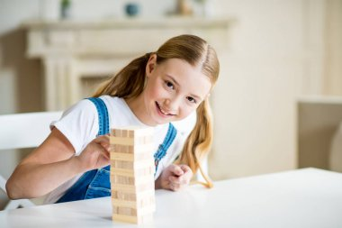 Girl playing jenga game