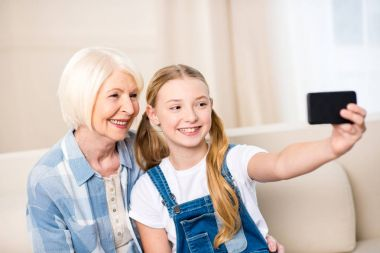 Girl with grandmother taking selfie
