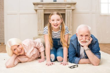 Happy girl with grandparents