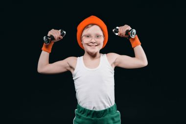 boy training with dumbbells