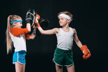 Boy and girl boxing