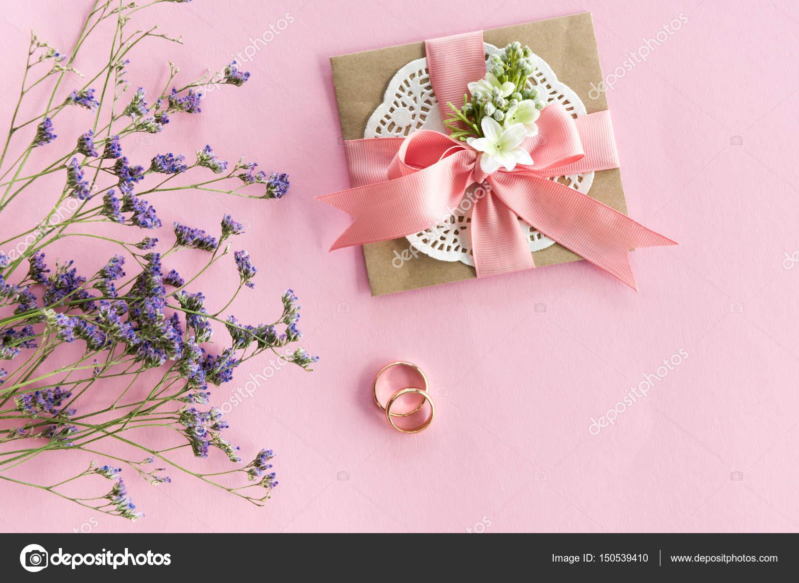 Wedding rings and envelope — Stock Photo © IgorTishenko #150539410